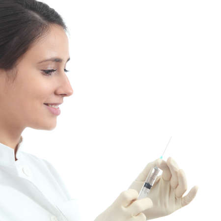 Beautiful nurse preparing a syringe on a white isolated background               photo