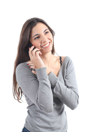 cellular phone call: Happy woman talking on mobile phone on a white isolated background