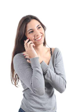 llamando: Mujer feliz hablando por teléfono móvil sobre un fondo blanco aislado Foto de archivo