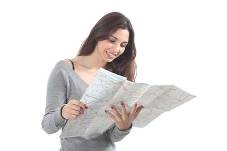 Beautiful woman smiling and watching a road map on a white isolated background Фото со стока