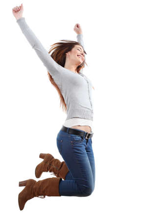 girl in jeans: Teenager girl jumping happy with her arms raised on a white isolated background
