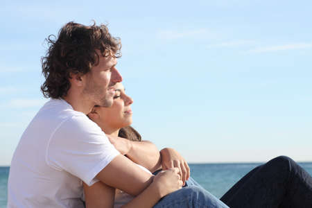 man woman hugging: Man and woman couple hugging on the beach and flirting under the sunlight