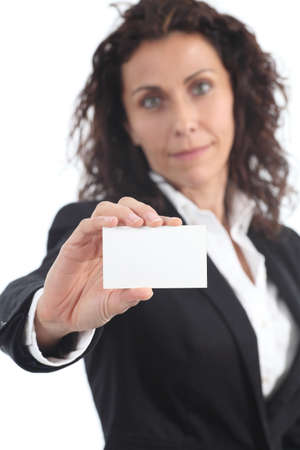 Beautiful mature businesswoman showing a blank business card  on a white isolated photo