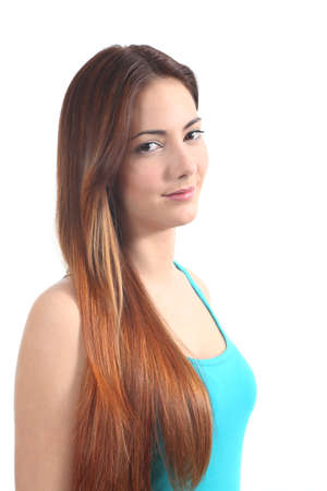 highlights: Beautiful redhead teenager smiling and looking at camera on a white isolated background