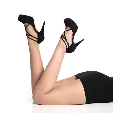 ankles sexy: Beautiful and fashion woman legs up with heels and tights on a white isolated background     Stock Photo