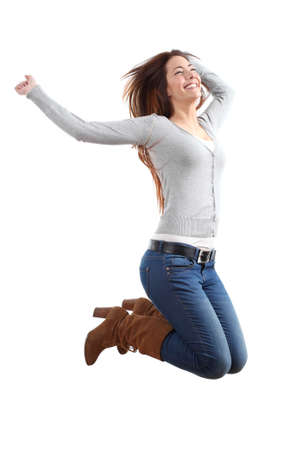 euphoric: Pretty teen jumping happy with her arms raised on a white isolated background Stock Photo