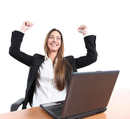 euphoric: Imprenditrice Euphoric guardando un computer portatile su uno sfondo bianco isolato Archivio Fotografico