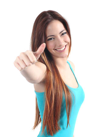 Beautiful happy teenager with thumb up gesture on a white isolated background photo