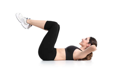 Beautiful woman doing abdominal crunches on a white isolated background