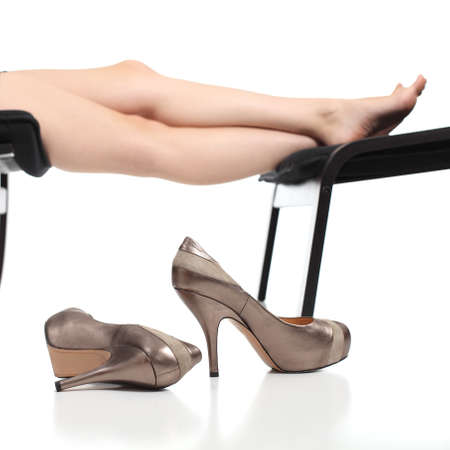 long feet: Portrait of a woman high heels with her legs in the background isolated on white    Stock Photo