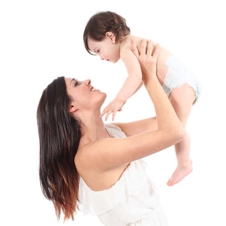 Beautiful mother raising her daughter looking with tenderness isolated on a white background            Stock Photo - 18693111