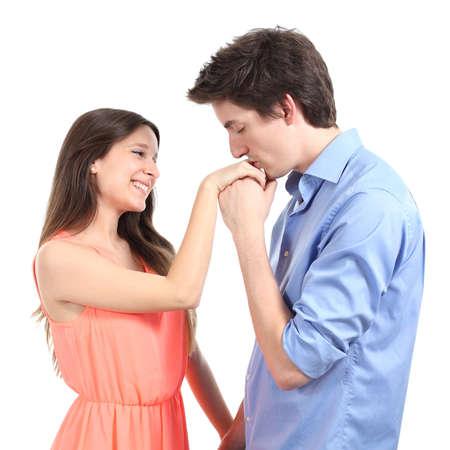 parejas enamoradas: Hombre que besa la mano de su pareja aislada en un fondo blanco Foto de archivo