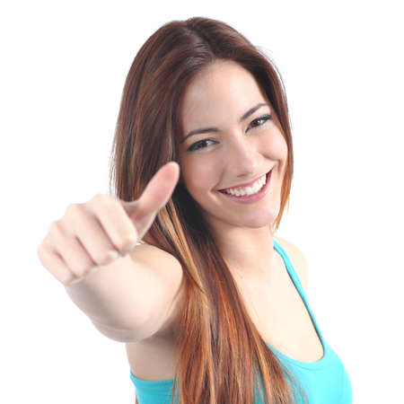 Close up of a beautiful teen with thumb up gesture on a white isolated background photo
