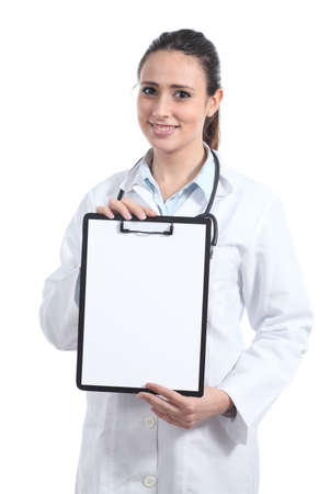 Beautiful female doctor showing a blank report isolated on a white background                  photo