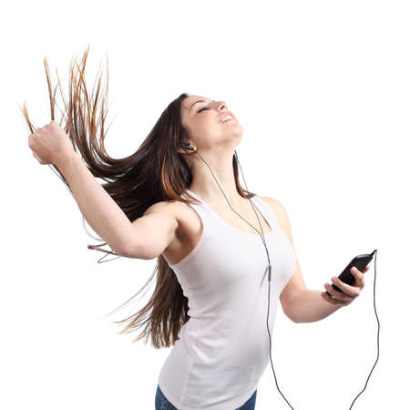 Beautiful woman dancing and listening to the music with headphones isolated on a white background                  photo