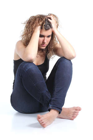 Portrait of a full body of a seated girl worried with both hands on the head on a white isolated background                Stock Photo