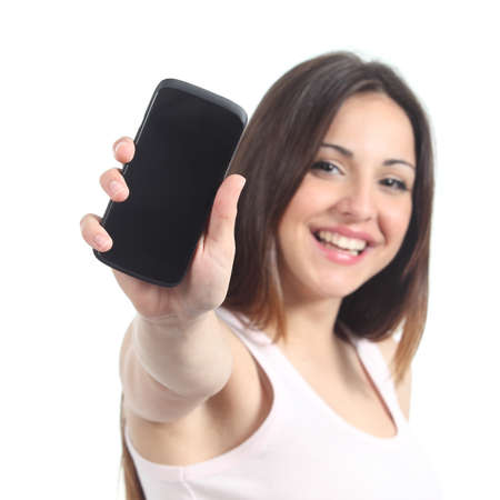 exhibiting: Happy woman showing a black mobile phone screen isolated on a white background