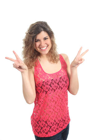 victory symbol: Young beautiful woman making victory or peace gesture isolated on a white background