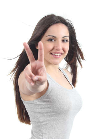 Beautiful teenager making victory or peace gesture isolated on a white background photo