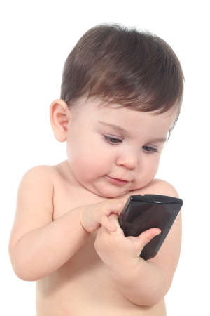 Beautiful baby playing and touching a mobile phone isolated on a white background  photo
