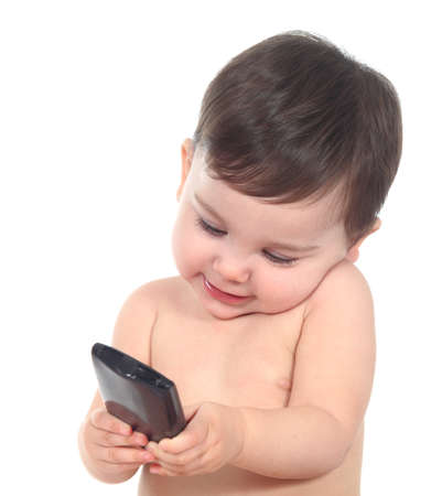 Beautiful baby playing and touching a smart phone isolated on a white background photo