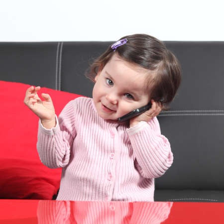 conversating: Portrait of a casual baby on the phone at home