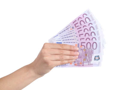 Woman hand paying a lot of five hundred euro banknotes on a white isolated background photo
