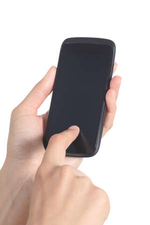 Woman hands holding and touching a mobile phone screen with her finger isolated on a white background             photo