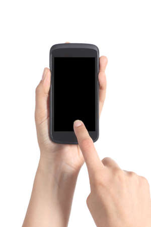 Close up of a woman hands holding and touching a blank mobile phone screen with her finger isolated on a white background               photo