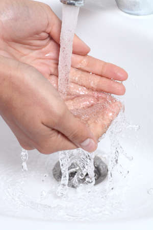 wasting: Woman washing her hands under a waterjet