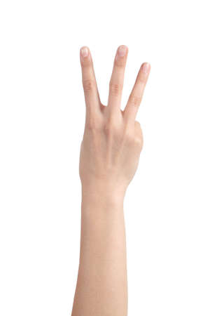 Woman hand showing three fingers on a white isolated background                photo