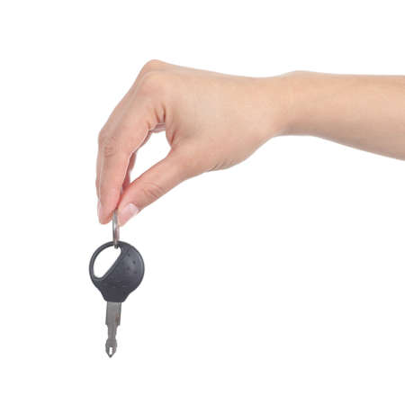 side keys: Side view of a woman hand giving a car key isolated on a white background Stock Photo