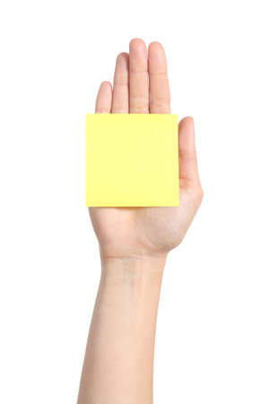 Woman hand palm holding a yellow notepaper on a white isolated background             photo