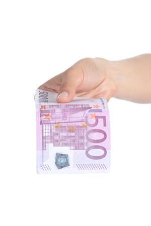 Woman paying a five hundred euros banknote isolated on a white background photo