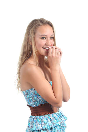 timidity: Happy teenager girl laughing timidly with her hands together in the mouth isolated on a white background                Stock Photo
