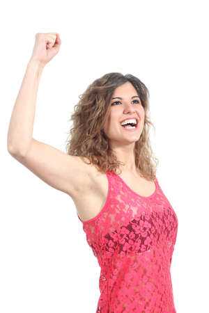 euphoric: Ecstatic beautiful girl with her arm raised isolated on a white background Stock Photo
