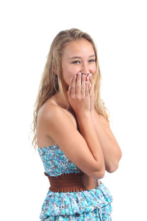 is embarrassed: Happy teenager laughing timidity covering her mouth with the hands isolated on a white background