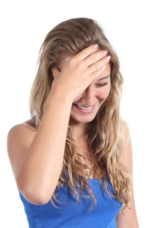 mirth: Happy teenager girl laughing with a hand in forehead isolated on a white background                Stock Photo