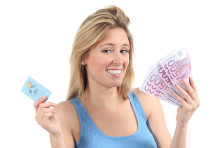 Woman doubting between money and credit card isolated on a white background Stock Photo - 20085486