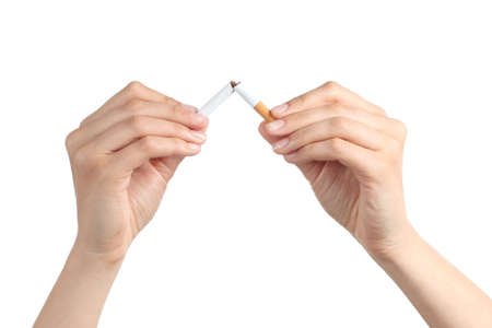 abusing: Woman hands breaking a cigarette isolated on a white background