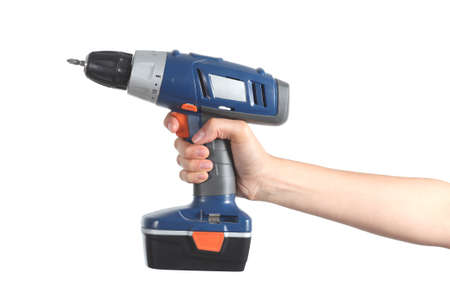 Profile of a woman hand holding a battery drill isolated on a white background             photo