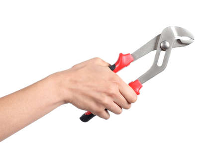 Woman hand holding a water pump pliers closed isolated on a white background photo