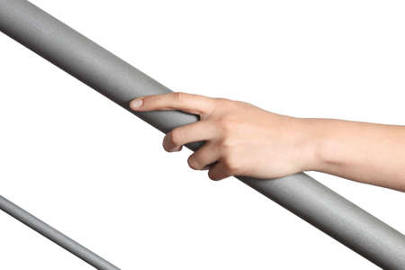 banister: Woman hand resting on a railing isolated on a white background Stock Photo