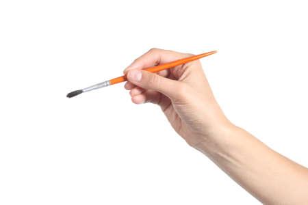 白い背景に分離した小さな絵筆を使って女性の手 写真素材