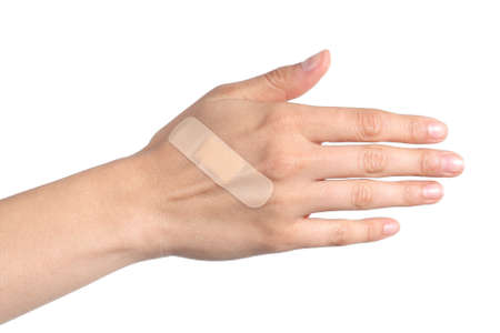 cut wrist: Woman hand with a band aid isolated on a white background Stock Photo