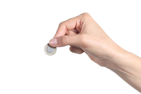 cheapness: Woman hand putting an euro coin isolated on a white background              Stock Photo