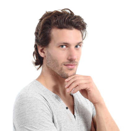 Sexy man looking at camera with the hand on the chin isolated on a white background                 photo