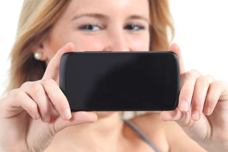 Horizontal view of a woman showing a black smartphone screen isolated on a white background photo