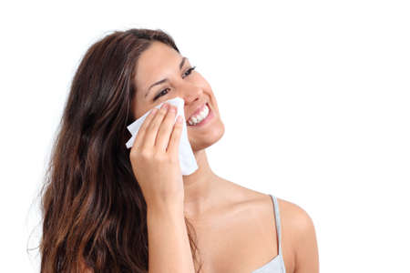 removing make up: Attractive woman cleaning her face with a face wipe isolated on a white background          Stock Photo