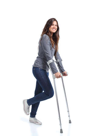 crutch: Woman walking with crutches on a white isolated background